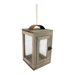 Wood and Wire Mesh Candle Lantern - With its modern design and its chique construction, this wood candle lantern is the perfect way to provide a little accent lighting inside and outside of your home. It measures 9.75 inches high, 6 inches wide, and 6 inches long.
