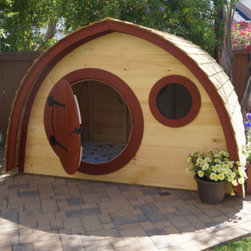 Hobbit Hole Playhouse by Hobbit Holes - This is so expensive, but it is just so amazing. What kid wouldn't love spending hours playing in a hobbit hole?