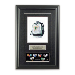 """Heritage Sports Art - Original art of the NHL 1996-97 Dallas Stars NHL Team jersey - This beautifully framed piece features an original piece of watercolor artwork glass-framed in an attractive two inch wide black resin frame with a double mat. The outer dimensions of the framed piece are approximately 17"""" wide x 24.5"""" high, although the exact size will vary according to the size of the original piece of art. At the core of the framed piece is the actual piece of original artwork as painted by the artist on textured 100% rag, water-marked watercolor paper. In many cases the original artwork has handwritten notes in pencil from the artist. Simply put, this is beautiful, one-of-a-kind artwork. The outer mat is a rich textured black acid-free mat with a decorative inset white v-groove, while the inner mat is a complimentary colored acid-free mat reflecting one of the team's primary colors. The image of this framed piece shows the mat color that we use (Silver). Beneath the artwork is a silver plate with black text describing the original artwork. The text for this piece will read: This is an original watercolor painting of the 1996-97 Dallas Stars jersey and was used in the NHL """"Next Six"""" print below and thousands of NHL """"Next Six"""" products that have been sold across North America. This original piece of art was painted by artist Tino Paolini for Maple Leaf Productions Ltd. Beneath the silver plate is a 3"""" x 9"""" reproduction of a well known, best-selling print that celebrates the history of """"The Next Six"""" 1967 expansion teams. The print beautifully illustrates the chronological evolution of each team's uniform and shows you how the original art was used in the creation of this print. If you look closely, you will see that the print features the actual artwork being offered for sale. The piece is framed with an extremely high quality framing glass. We have used this glass style for many years with excellent results. We package every piece very carefully in a double layer"""