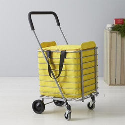 Polder® Folding Shopping Cart with Insulated Yellow Liner - Life meets style™ at the intersection of form and function courtesy of the bright minds at Polder® Housewares. Sturdy yet lightweight aluminum shopping cart rolls easy with front wheels that rotate a full 360 degrees for easy steering. Cart holds up to 30lbs. and folds flat with a simple lift motion for easy portability and storage. Insulated yellow liner features generous capacity, zipper closure and carrying handles. On the inside, aluminum lining with sponge padding keeps foods cold and protected. Liner affixes easily to cart with fabric tab fasteners.