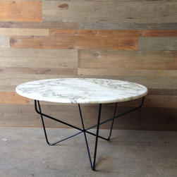 Calacatta Marble Table, Tri-Mod Base - This marble-topped table is so chic. I love the simple style and black contrast of the base.