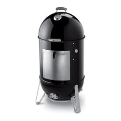 Weber - Smoker: Weber Smokey Mountain Cooker Smoker 22.5 inch - Shop for Smokers from Hayneedle.com! Nothing is better than great smoke meats and fish and here is your Weber smoker to help you do that. This oversized smoker features 726 sq inches of cooking space over it's two heavy duty plated-steel cooking grates and a porcelain-enameled water pan so the meat stays moist and tender. Four no rust aluminum vents and a no rust aluminum fuel door ensures that you will be using this smoker for years to come. A premium grade cover is included. About Weber GrillsWeber-Stephen Products Co. headquartered in Palatine Ill. is the premier manufacturer of charcoal and gas grills grilling accessories and other outdoor room products. A family-owned business for more than 50 years Weber has grown to be a leading seller of outdoor grills worldwide.
