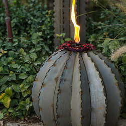 """Frontgate - Ferocactus Outdoor Torch - 9""""H - Constructed of galvanized steel. Verdigris patina finish that will darken over time. Hollow and perforated throughout with a hole in the base, which allows for landscape lighting to be added for a special evening glow. Includes three refillable torch canisters. Recommend Paraffin oil for use in torch canisters (sold separately). Carefully crafted to realistically represent the beloved Saguaro Cactus, this torch will illuminate your landscape. This work of art expertly combines a landscape sculpture with unparalleled creative detail and three torch canisters for an outdoor accent that's unique, functional and durable.  .  .  .  . . Each canister holds 5 ozs. of oil and contains a 10"""" fiberglass wick. Wick should be pulled out 1"""" for burning. Made in the USA."""