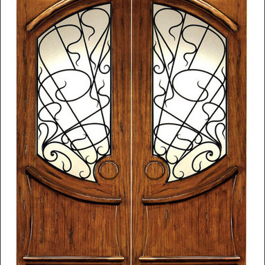 Art Nouveau Entry Doors Model # AN-2001 - Art Nouveau is an art, style, and architecture recognized around the globe.  This door and collection will set you apart from the rest while giving your home a very unique look.  These doors have fine carvings, iron work and most have a operable glass panel to facilitated the cleaning of the iron panel.  Look at the entire collection to find the right fit!