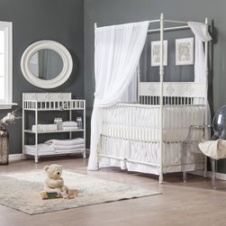 Bratt Decor Wrought Iron Indigo 2 in 1 Convertible Crib Collection - Distressed - Give your nursery a touch of elegance combined with stylish functionality with the Bratt Decor Wrought Iron Indigo 2 in 1 Convertible Crib Collection – Distressed White. This crib collection is made of durable wrought iron and features intricate details and a distressed white finish for a sophisticated look that enhances any nursery setting. This set includes a two-in-one crib as well as a handy changing table. Its four-post design adds a way to provide a helpful and beautiful canopy. When your child gets older this crib easily converts to a full-size canopy bed when you add the conversion kit (not included). The changer fits standard 32 x 16 changing mats and offers storage and organization for all your baby's necessities. About Bratt DecorBratt Decor was born out of necessity after Mary and Stephen Bauer's long trying and unsuccessful journey to find the perfect crib. The couple sought a crib that would bring beauty harmony sophistication and balance to their nursery. They wanted sumptuous luxurious and comfortable. And they wanted the nursery to feel like home. After scouring every store in two major U.S cities the couple was disappointed in the selections. Nothing fit their vision and those that came close were beyond their budget. That's when the Bauer's took matters into their own hands and built their own crib. They realized there must be other discouraged parents out there disappointed in the cribs available. That's when Bauer's set out to start their own business to make the world's most beautiful cribs at prices normal people could afford.