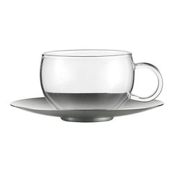 Jenaer Glas - Jenaer Glas Good Mood Cup with Stainless Steel Saucer - Set of 2 - 6.8 oz. Multi - Shop for Travel Mugs and Tumblers from Hayneedle.com! Upgrade your morning ritual by drinking from the Jenaer Glas Good Mood Cup with Stainless Steel Saucer - Set of 2 - 6.8 oz.. This set of dishwasher-safe morning essentials includes two clear Borosilicate glass cups and two sleek stainless steel saucers. About Fortessa Inc.You have Fortessa Inc. to thank for the crossover of professional tableware to the consumer market. No longer is classic high-quality tableware the sole domain of fancy restaurants only. By utilizing cutting edge technology to pioneer advanced compositions as well as reinventing traditional bone china Fortessa has paved the way to dominance in the global tableware industry. Founded in 1993 as the Great American Trading Company Inc. the company expanded its offerings to include dinnerware flatware glassware and tabletop accessories becoming a total table operation. In 2000 the company consolidated its offerings under the Fortessa name. With main headquarters in Sterling Virginia Fortessa also operates internationally and can be found wherever fine dining is appreciated. Make sure your home is one of those places by exploring Fortessa's innovative collections.