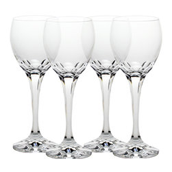 Martinka Crystalware & Lifestyle - Kaleidocut White Wine Glasses (Set of 4) - The Kaleidocut wine glasses are beautifully hand cut in the shape and form of a flower. When looking into the wine glass you are greeted with a design that captures the petals and eye of a blossom. The floral design further unfolds into an exhibit of unique lenses that multiply reflections and light like the mirrors and effects within a kaleidoscope.