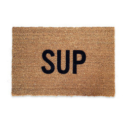 Reed Wilson - Sup - These mats are manufactured in the USA from natural coir (coconut) fiber bristles, which are inserted into a weatherproof vinyl backing. Designs are applied through an electrostatic flocking process, which permanently bonds the colored fibers to the coir fibers.
