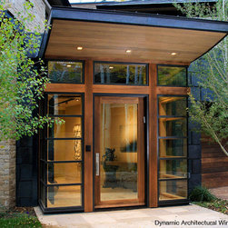 Modern Entry Door with Corner Sidelites - This modern entryway features a wood door with corner sidelites and transom by Dynamic Architectural Windows & Doors.