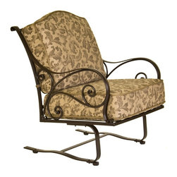 O.W. Lee - O.W. Lee Ashbury Spring Base Aluminum Club Chair - 1581-SB-SP11-GL02A - Shop for Chairs and Sofas from Hayneedle.com! If this O.W. Lee Ashbury Spring Base Club Chair is a' rockin' don't come a' knockin'. Sometimes the whole point of sitting outside and watching the world go by is having time to think by yourself. This large comfortable chair provides an outdoor seating experience perfect for that kind of relaxing. Its wide seat sturdy arms and thick cushions allow you to sink right in while the spring base gently rocks your cares away. The beautiful scrollwork adds to your outdoor decor a classic appeal that also possesses a fashion-forward individuality. This sensually curving metalwork is hand forged and hammered bringing a uniquely masterful craftsmanship to these chairs.Materials and construction: Only the highest quality materials are used in the production of O.W. Lee Company's furniture. Carbon steel galvanized steel and 6061 alloy aluminum is meticulously chosen for superior strength as well as rust and corrosion resistance. All materials are individually measured and precision cut to ensure a smooth and accurate fit. Steel and aluminum pieces are bent into perfect shapes then hand-forged with a hammer and anvil a process unchanged since blacksmiths in the middle ages. For the optimum strength of each piece a full-circumference weld is applied wherever metal components intersect. This type of weld works to eliminate the possibility of moisture making its way into tube interiors or in a crevasse. The full-circumference weld guards against rust and corrosion. Finally all welds are ground and sanded to create a seamless transition from one component to another. Each frame is blasted with tiny steel particles to remove dirt and oil from the manufacturing process which is then followed by a 5-step wash and chemical treatment resulting in the best possible surface for the final finish. A hand-applied zinc-rich epoxy primer is used to create a protective