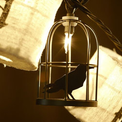 Caged Crow String Lights - Although the Caged Crow String Lights are great for an outdoor party, they can also look great inside. String them up through the entryway.