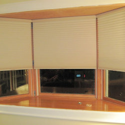 Window Treatments-Shades, shadings, sheers - Honeycomb, or cellular, shades with cordless lift, in bay window by Jeffrey M. Stein, window coverings professional, North Shore Decor.