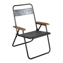 Reclaimed Metal Folding Chair - Spruce up your outdoor space with this simple but sophisticated folding chair. Made of reclaimed iron and accented with reclaimed teak arm rests, the chair folds up for storage when not in use. Take a seat while you're BBQing, bring it on your next camping trip, or use it for extra seating when you're entertaining.