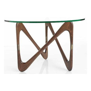 Moebius Table - This table has the appearance of a one-of-a-kind flea market steal, but luckily it is readily produced and available for all who are willing to spend. The polished wood base paired with the glass top are clean and simple and perfectly mid century.