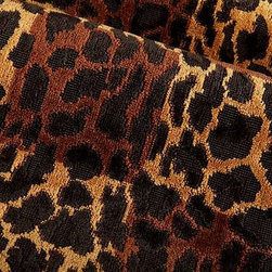 Leopard Square Upholstery Fabric in Brown - Leopard Square Upholstery Fabric in Brown is an eclectic animal print chenille with a check pattern created with alternating shades of brown. This leopard print linen-cotton blend has a hearty hand perfect for upholstering sofas, chairs, and more. Made in France from a blend of 67% linen, 25% cotton, and 8% polynosic. Width: 52?; Repeat: 25.5?