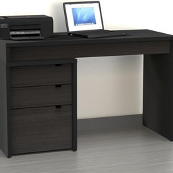 Nexera - Nexera Sereni-T Computer Desk with Filing Cabinet - Black - MFI415 - Shop for Desks from Hayneedle.com! Constructed of engineered wood the Nexera Sereni-T Computer Desk with Filing Cabinet - Black is finished in a commercial-grade melamine coat that resists scratching and is easy to clean. The extra-big desk surface can be reversed for easy configuration in any room while the filing cabinet has one legal-size file drawer and two storage drawers all with sturdy metal glides and pulls. Filing cabinet measures 18.87W x 19.75D x 24.5H inches.About NexeraNexera whose name is a combination of the words next era is a Canadian manufacturer of affordable ready-to-assemble furniture known for its innovative cosmopolitan style. At their factory in Laval Canada Nexera employees utilize state-of-the-art equipment to manufacture their modern furniture collections including bedroom collections entertainment furniture office furniture and utility furniture.From start to finish Nexera upholds high standards of care for the environment when making their furniture. All raw material (particle board) originates from FSC (Forest Stewardship Council) certified forests only and energy used comes from renewable sources only such as hydro-electricity and windmill power. Nexera meets the CARB (California Air Resources Board) requirements for clean air and it recycles over 92% of its factory waste. Nexera products are packaged with 100% recycled fibers. Because of the materials they are constructed with Nexera products are also able to be recycled at the end of their life cycle which reduces landfill waste.