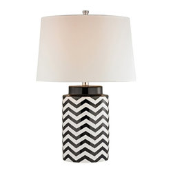 HGTV HOME - HGTV HOME Energy Black & White Chevron Table Lamp - HGTV339 - Shop for Lamps from Hayneedle.com! Add modern beauty to your home with the HGTV HOME Energy Black & White Chevron Table Lamp. Featuring a black and white chevron pattern this lamp is accented by a pure white faux silk shade and adds a look of sophisticated beauty in your home. This lamp uses uses one 150 watt medium bulb (not included). About E.L.K. LightingIn 1983 Adolf Ebenstein Jonathan Lesko and Russell King combined their lighting expertise to form E.L.K. Lighting Inc. From the company's beginning in eastern Pennsylvania it has become a worldwide leader featuring manufacturing facilities and showrooms in the U.S. and abroad. Award-winning designs and state-of-the-art engineering give their lighting and home decor items outstanding quality and value and has made E.L.K. the choice of such renowned places as the Historic Royal Palaces of England and George Vanderbilt's Biltmore Estates. Whether a unique custom design or one of their designer lines all products are supported by highly trained technical and customer service teams. A commitment to providing superior lighting and home products with unmatched customer satisfaction remains at the heart of the E.L.K. family tradition.