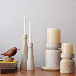 Hourglass Stone Candleholder - A modern stone age family. Shapely stone holders lend weighty presence to pillars and tapered candles.