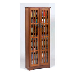 Leslie Dame - Mission Style Multimedia Glass Door Cabinet w - Color: OakPictured in Walnut. Have fully adjustable shelves allowing for storage of DVD's, CD's, Videocassettes, and Game Cartridges. Holds 477 CD's, 222 DVD's, or 120 VHS Videocassettes. Including hand-rubbed Oak Veneer, Tempered Glass and Antique finished Metal door pulls. Some assembly required. 24 1/2 in. W x 9 1/2 in. D x 61 3/4 in. H (82 lbs.)Multimedia Storage Cabinets has the rare combination of timeless design and high quality construction.