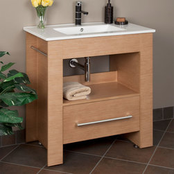 "32"" Warbeck Console Vanity - Pearwood - The 32"" Pearwood Warbeck console vanity features a porcelain countertop with integral sink, one large soft-closing drawer, a spacious open shelf and two built-in towel holders. Add a single-hole lavatory faucet to complete the look."