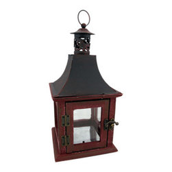 Rustic Distressed Red Lantern Style Candle Holder - This beautiful metal, wood and glass decorative lantern style candle holder has a wonderfully rustic, distressed red enamel finish finish. The lantern features an antiqued brass opener on the door, and has a heat resistant silvered plate on the bottom for safety.It has a hanger ring on top, so you can hang it from eaves or trees, and has a flat bottom, so it can be displayed on tables or decks. The lantern is 11 1/2 inches tall (12 1/2 inches including the hanger), 5 3/4 inches wide and 5 3/4 inches deep. It can accept pillar candles up to 3 inches in diameter and 4 inches tall. It makes a great gift for friends and family.