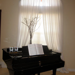 Yardena | Arch Window with Pleated White Sheer Drapes - Foyer/Entrance area: