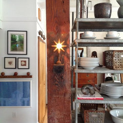 LIGHT IN LIVING SPACES - Thing One and Thing Two - these wall sconces were refashioned from burners off a gas stove. Consider these as an architectural detail, adding an element of surprise to your living space.