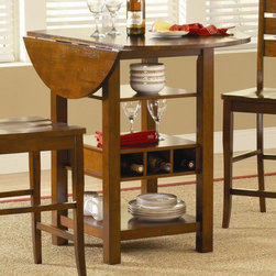 """Bernards - Ridgewood Counter Height Drop Leaf Dining Table with Storage - Mahogany Brown - - Shop for Bar and Pub Tables from Hayneedle.com! When space is at a premium get the Ridgewood Counter Height Drop Leaf Dining Table with Storage Mahogany. Complete with two drop leaves so you can reduce and expand your table top as needed this piece also features three storage shelves and a built-in wine rack. So now you have room for displays and dinner plates right at the table. It's crafted from durable wood to last and the mahogany finish keeps it classic. Assembly required. This purchase is for the table only please see """"Related Items"""" for matching chairs or complete dining set. About BernardsBernards is an importer and distributor of residential home furnishings. They offer products for all rooms at affordable prices and styles from traditional to contemporary. In order to bring the best values to their customers Bernards shops the world for specialties to meet the needs and desires of their retailers and customers. Located in Archdale NC. Bernards was founded in 1983 by Herman Bernard a pioneer in furniture importing. He set the standard for integrity that has been the foundation of the company ever since. You can count on Bernards to give you the facts and stand behind the products they sell."""