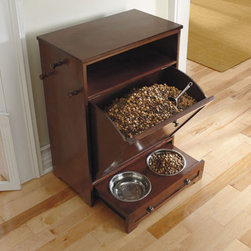 Grandin Road - Pet Feeder Station - Kibble drawer cleverly disguises food and conveniently tilts out for easy access. Storage area holds 10 lbs. of food. Removable stainless steel food and water bowls slide out of sight for when guests arrive. Finished in a rich espresso, with metal hardware. Easy assembly to attach the three exterior, wood hanging hooks. Enjoy the convenience of food, leash, and toy storage, plus a feeding station, all in one stylish, compact space with our Pet Feeder Station. This storage cabinet is made to the same high level of craftsmanship as our other furniture pieces with a sturdy blend of solid mahogany and engineered woods.  . .  .  .  .