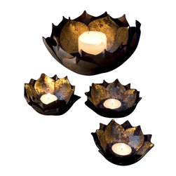 Gold Leafed Metal Lotus Candle Holders - Large - Create a serene and magical glow with these gold leafed candle holders. Inspired by the shape of the Lotus flower these are hand carved from Metal and gold leafed to give it an antique finish. Adorn your festivities with a golden glow with these candle holders.