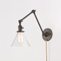 Princeton Senior - I am using two of these over the vanity in one of my projects. I like several different varieties of these swing-arm sconces, but this is the only one I have seen that has a glass shade option. With an Edison bulb, it is really going to help give the bathroom a classic charm.