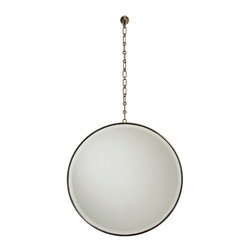 Fletcher Mirror - Antique Brass - Unusually interpreting the wall mirror as a hanging element on a thin chain, the design of the Fletcher Mirror in Antique Brass is reminiscent of a lens but offers a clear, useful reflection. The design is ideal for antique homes with a picture rail, and in any room, it creates visual height with the vertical stretch of its chain. Pair with vintage-inspired accents for a picturesque wall.