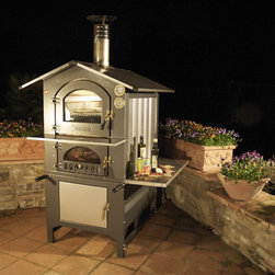 Fontana Gusto Wood-Fired Oven - Looking for a wood fired oven without the commitment of an immovable brick oven which takes forever to fire? This portable wood fired oven actually has a convection fan to distribute heat evenly and fires in 45 minutes. Wood fired pizza, chicken, fresh bread, all with that great wood flavor and crust.