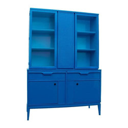 """Pre-owned Mid-Century Hutch in Blue Lacquer - Bright blue Mid-century hutch, we love you - from your dangerously good looks, to your functional but endlessly fun personality. This two piece set can be used as a China Hutch when both pieces are combined on top of one another, or can be separated if desired.    The top """"china"""" cabinet has 2 glass doors, 2 shelves for display, and a textured center divider on the front. And if that isn't enough, let's talk about it's lower half: the bottom buffet features 2 deep drawers, one with wood dividers for silverware, and 2 bottom doors for easy access. The detailed brochure in still inside, which makes for a fun furniture history lesson and a great conversation starter!"""