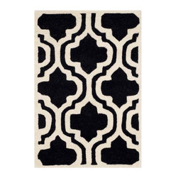 Safavieh - Collins Hand Tufted Rug, Black / Ivory 2' X 3' - Construction Method: Hand Tufted. Country of Origin: India. Care Instructions: Vacuum Regularly To Prevent Dust And Crumbs From Settling Into The Roots Of The Fibers. Avoid Direct And Continuous Exposure To Sunlight. Use Rug Protectors Under The Legs Of Heavy Furniture To Avoid Flattening Piles. Do Not Pull Loose Ends; Clip Them With Scissors To Remove. Turn Carpet Occasionally To Equalize Wear. Remove Spills Immediately. A timeless quatrefoil motif makes a global design statement in the subtle but sophisticated Desai area rug. These stunning hand-tufted wool rugs are crafted in India to recreate the elegant look of hand-knotted carpets for today's lifestyle interiors.