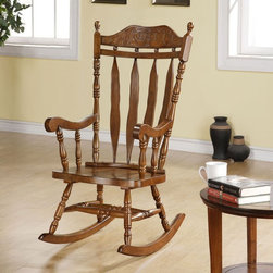 Monarch - Monarch Dark Walnut 45H in. Solid Wood Rocking Chair Brown - I 1515 - Shop for Rocking from Hayneedle.com! The Monarch Dark Walnut 45H in. Solid Wood Rocking Chair is a richly detailed country-style accent that s been crafted from wood in a dark walnut finish. A beautiful addition to nurseries or traditional interiors this classic arrow-back rocker features artfully carved details throughout including a shapely curved top with decorative floral pattern finial-accented posts turned legs and leg stretchers and scrolled arms supported by elegant turned spindles. About Monarch SpecialtiesWilbur Berger established Monarch Glass in 1950 on Rachel Street in Montreal providing quality custom mirror and glasswork for both retail stores and the home. Understanding that there was more business with glass Monarch started manufacturing and then diversified to importing mirrors and frames. Currently the company is centered in Quebec where it is a leader among furniture importers and distributors focusing on fashion forward designs and impeccable customer service.
