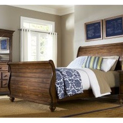 Hamptons Sleigh Bed - Dark Pine - You'll love the absolutely stunning presence the Hamptons Sleigh Bed - Dark Pine brings to the bedroom. Crafted of solid pine wood and completed in a wonderfully weathered pine finish this gorgeous sleigh bed really makes a room come alive. Plus its classic bun feet add a traditional charm that will work well with many home decors. About Hillsdale FurnitureLocated in Louisville Ky. Hillsdale Furniture is a leader in top-quality affordable bedroom furniture. Since 1994 Hillsdale has combined the talents of nationally recognized designers and globally accredited factories to bring you furniture styling and design from around the globe. Hillsdale combines the best in finishes materials and designs to bring both beauty and value with every piece. The combination of top-quality metal wood stone and leather has given Hillsdale the reputation for leading-edge styling and concepts.