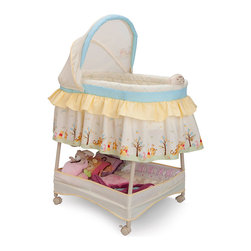Winnie the Pooh - Winnie the Pooh Gliding Bassinet - Three lullabies, a night-light and gentle vibrations help soothe little dreamers to sleep, surrounded by whimsical illustrations of Winnie the Pooh. Locking casters offer room-to-room maneuverability, and a large basket underneath provides convenient storage.   Includes bassinet, pad and fitted sheet Weight capacity: 15 lbs. Gliding base Storage basket Locking casters Night-light Three preloaded lullabies Variable speed vibration Removable adjustable canopy 45.5'' W x 32'' H x 17.5'' D 14.3 lbs. Steel / polyester Requires four AA batteries (not included) Imported