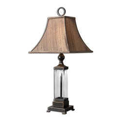 Uttermost - Bartlet Glass Table Lamp - This lamp allows you to see things a little more clearly. It features a mouth-blown glass base topped with a bronze-hued fabric shade that's lined to softly diffuse light.
