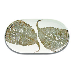 Frontgate - Caskata Sea Fan Oval Platter - Chic white and platinum color scheme complements a range of decor styles. Food-safe platinum. Lead-free porcelain. Not microwave-safe. Hand wash. A delicate application of platinum on white porcelain creates a dramatically detailed, elegant tablescape. The hand-applied design of our Sea Fan Dinnerware features individual leaves on the bowls, platter and mug, and an up-close, abstract border on the plates and charger.  .  .  .  .  . Made in USA.