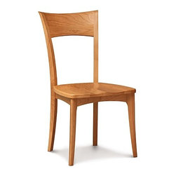 Copeland Furniture - Copeland Furniture | Ingrid Side Chair With Wood Seat - Made in Vermont by Copeland Furniture.The Ingrid Side Chair With Wood Seat is a classic open back chair with the integrity and beauty of a handcrafted Copeland piece. Crafted in FSC-certified American black walnut or cherry hardwood, this side chair features a tall open back, slim legs and a contoured wood seat. Pair the Ingrid Side Chair With Wood Seat with any of Copeland's beautiful dining tables and buffets for a complete modern dining room.  The Ingrid Side Chair With Wood Seat by Copeland Furniture is crafted from sustainably harvested hardwoods from the American Northern Forest. All lumber used by Copeland Furniture comes from within 500 miles of their factory in Vermont, thus reducing fossil fuel consumption and carbon dioxide emissions from transportation. The environmental values of preservation and stewardship are reflected in every piece of furniture produced by Copeland Furniture.