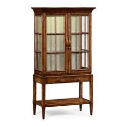 Jonathan Charles - Jonathan Charles Huntingdon Country Farmhouse Walnut China Cabinet - Country style planked walnut glazed display cabinet with internal lighting two doors and adjustable glass shelves. Long wooden strap handle to the single drawer with patinated brass details. Jonathan Charles Fine Furniture is the vision of Jonathan Sowter an English furniture designer who excels at the art of fine antique reproduction. Jonathan Charles designs and manufactures the highest-quality European antique replicas as well as their own unique transitional designs. What makes them different is their meticulous attention-to-detail and pursuit of high-quality construction. Their passion for detail is also reflected in their in-house brass foundry in which they manufacture their own hardware so that when they design a new piece of furniture they can also design one-of-a-kind pulls hinges locks and even keys for that piece. Jonathan Charles works with artisans who display a large range of skills. They take pride in their work which is evident in their beautifully-crafted antique replicas. They go far beyond just creating furniture that resembles English classics. They employ age-old techniques which breathe soul and lasting-quality into their products.  Many of their inspirations come from original antiques that Jonathan discovers in his travels. Sometimes they will reproduce them as accurately as possible while at other times they will take a detail that they like and design a completely new piece of furniture around that feature.  Oftentimes they will start the design process from scratch. They gather inspiration from a variety of sources – be it a classic wallpaper design nature classic antiques a rare object or jewelry.  They never design to the limitations of their factory and have actually expanded their factory as they have developed new skills in advanced marquetry bronze casting hand carving and much more.  They never compromise on design and would be foolish to compro