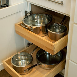 CliqStudios.com - Roll Out Trays - No more reaching around trying to find something buried in the back of a cabinet. Our full extension roll-out trays bring the entire cabinet contents directly to you, ending your search time and extending your preparation time!