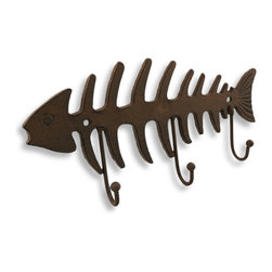 Cast Iron Fish Bones Wall Hook - Don't let this one 'get away'! This fish bones wall hook would look great 'scaling' the walls of any outdoorsy themed home. It's made from cast iron, has three hooks and finished in a rustic style. It measures 12.5 inches long, 6.5 inches high and 1.75 inches deep. Hang your oven mitts from his hooks to always have them near when removing your 'catch of the day' from the oven!