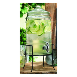 Home Essentials - Cylinder Ribbed Glass Beverage Dispenser on Iron Rack - Dispense your favorite tasty beverages in style using our clear glass drink dispenser on wrought iron rack. Fill this gorgeous beverage dispenser with ice cold water or bright pink lemonade for a chic, modern addition to any celebration! Constructed from thick, high quality glass, this beverage essential will hydrate guests and keep the host at ease for years to come. Our beautiful, classic-looking beverage dispenser looks great on your patio, kitchen counter and anywhere else you want to use it. The metal stand conveniently elevates jar for an attractive presentation and easy dispensing indoors or out.