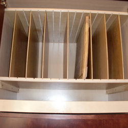 Above Fridge & Oven Tray Dividers and Pull Out Shelf - Install tray dividers in the cabinet above your refrigerator or oven to make better use of a high space.  Beneath the tray divider is a pull out shelf for additional storage with ease of access.