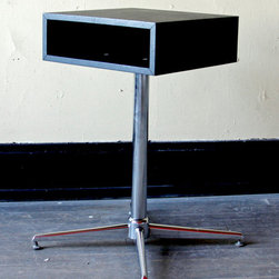 Mod Side Table - This table is so sleek! It's mod and minimalist and cool. And would work perfectly with a brightly-colored lamp or chair. Faux leather-covered wood top (with a handy little nook inside the shelf) and chrome cross base.