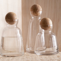 Roost - Copenhagen Carafe - Medium - Clean lines and natural materials create the elegant simplicity of these carafes. Each hand-blown, clear glass vessel features a wooden sphere stopper. Available in three sizes, these carafes make a beautiful addition to a dining table, home bar or bedside.