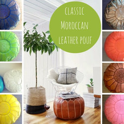 classic Moroccan pouf - These versatile camel leather poufs can be used as a footstool, occasional seating or as a side table with one of our beautiful trays on top.  Have fun and add a pop of color to any space!