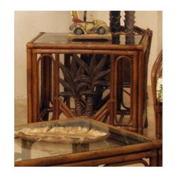 Hospitality Rattan - Cancun Palm Rattan & Wicker End Table & Glass - A slatted lower shelf and palm tree accents on the side panels bring a rustic look to this woven wicker and rattan end table, a beautiful way to add an island inspired influence into your home decor. The table has a glass top and is available in your choice of finish options. This product is warranted for indoor use. Made of Rattan Poles and Woven Wicker. Traditional indoor upholstered wicker end table with glass. Glass included. Handmade piece of furniture. Herringbone wicker weave. Woven Leather Bindings. Pictured in Antique. Fully assembled with Palm Tree decor. 26 in. W x 21 in. D x 22 in. H (35 lbs.)This Cancun Palm Upholstered Seating collection is one of our exclusive and largest collections of fine rattan and herringbone wicker weaving. That has a fiber palm tree castings design. The woven leather bindings used throughout Cancun Palm ensures its durability and quality for many years of use. It enhances the tropical look in any living room or Florida room. This upholstered collection is assembled in the USA, and also shows the fabric along the rear of the seating pieces. The selection of three finishes also compliment any room decor. In addition your choice of over 45 fabrics is available on the Cancun Palm Collection. The optional sleeper sofabed is available.